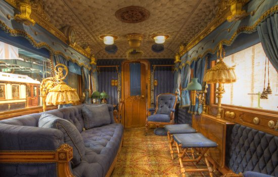 Interior of a royal carriage furnished in gold and blue