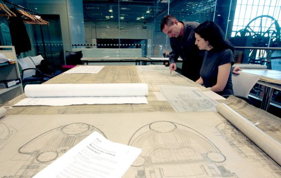 Andy Croxton with Mary White, National Railway Museum (NRM) Visitor Service Assistants examining one of the many Engineering Drawings from the museum collection, 2010.