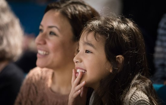A mother and daughter watching a science show