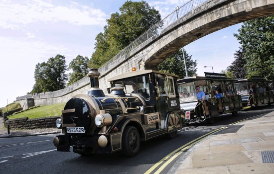 The road train passes York's city walls