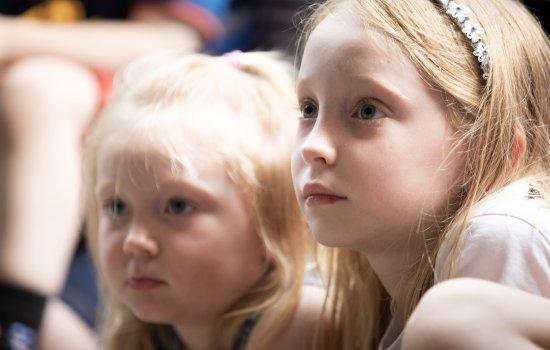 Two girls listening carefully