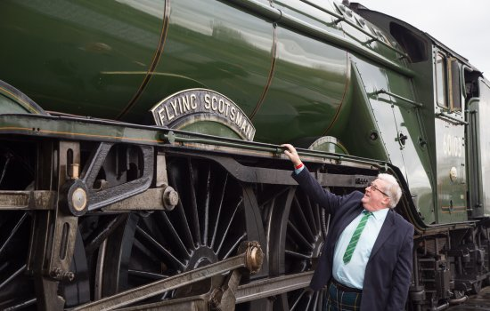 Sir William McAlpine next to Flying Scotsman