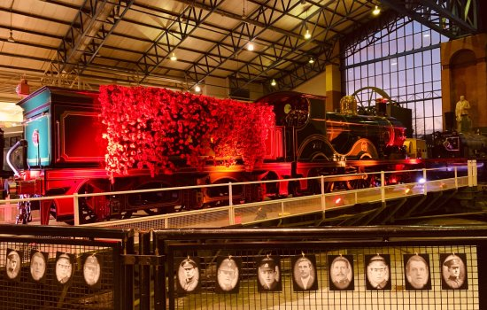 A locomotive covered in poppies