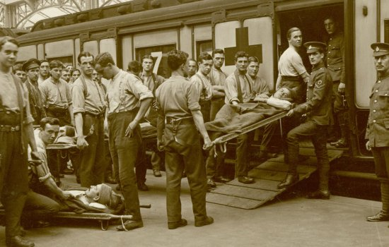 Servicemen loading an injured soldier onto an ambulance train, First World War