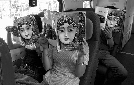 Passengers read the same free magazine
