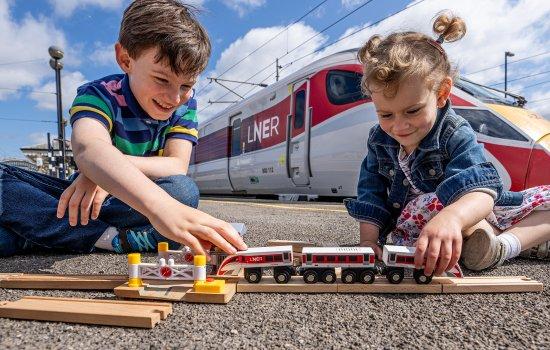 Children play with Azuma toy train