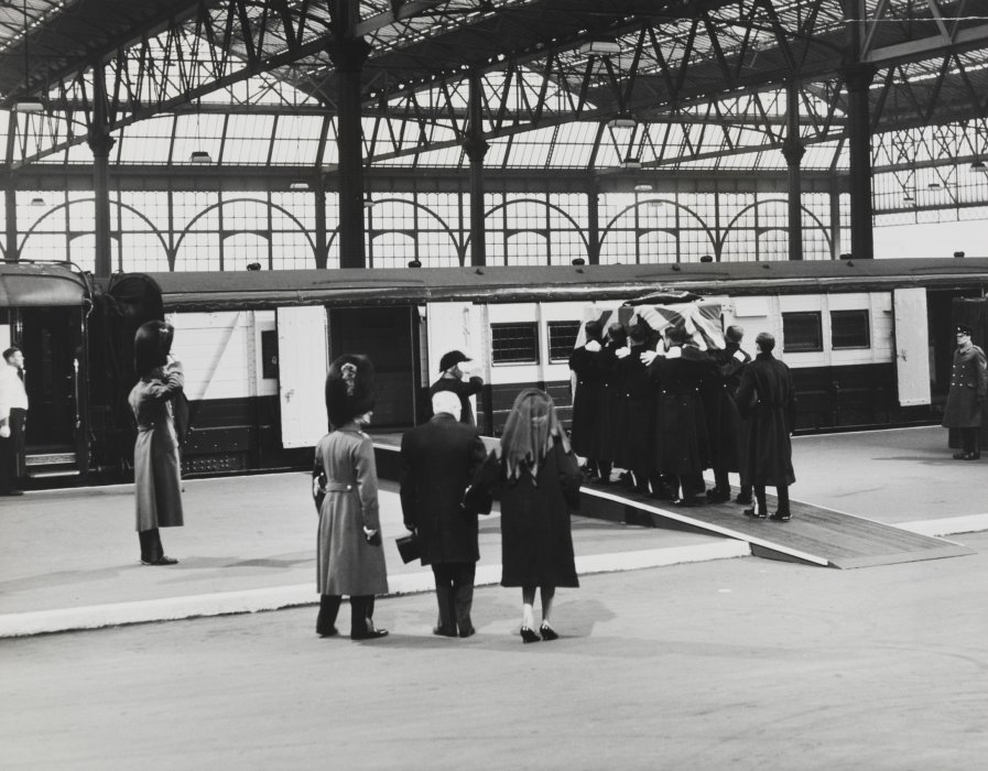 Churchill's coffin being loaded onto the baggage van
