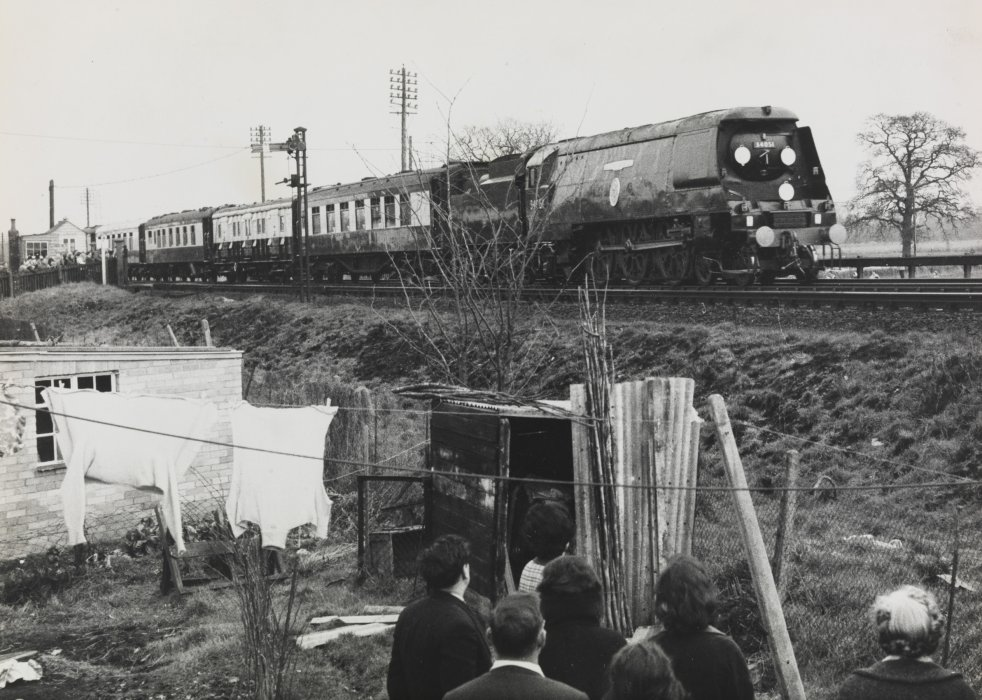A group of boys look on as the funeral train passes on 30 January 1965