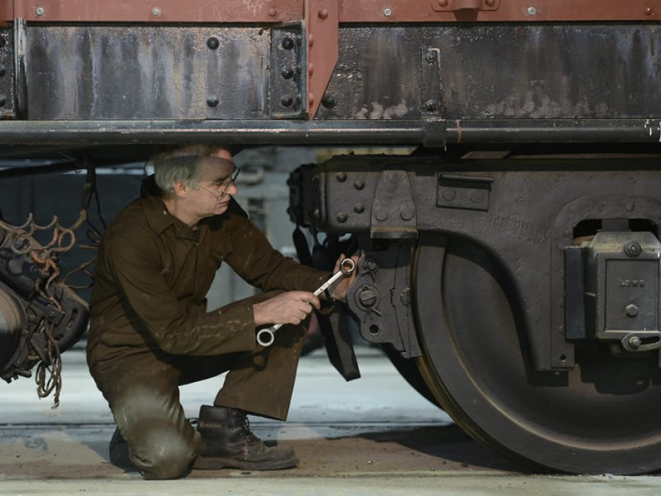 Attention to detail as Jeff works on the underframe of the van at Shildon