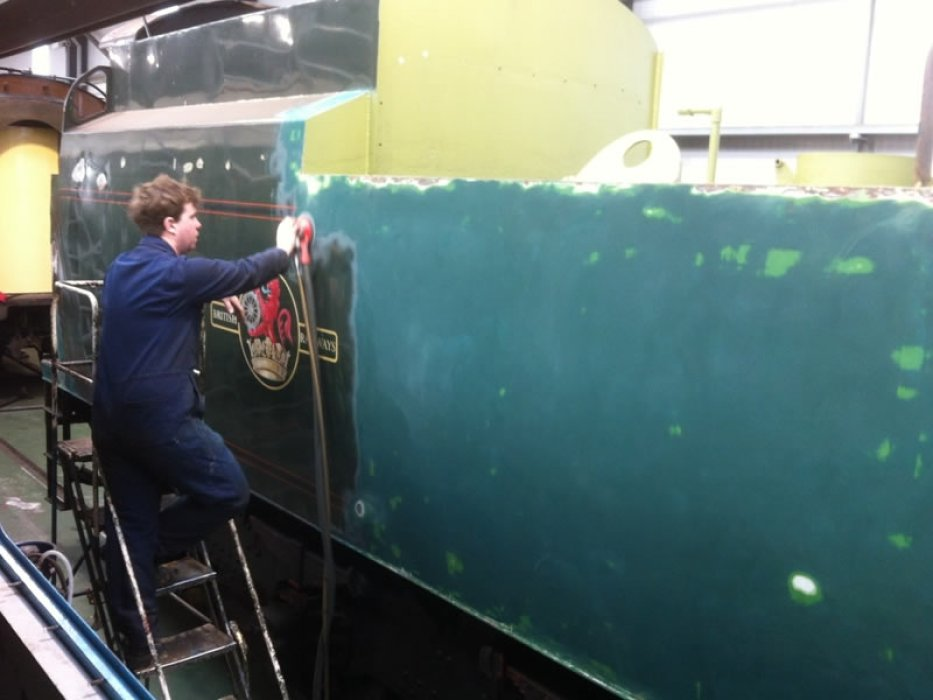 Ollie sands down the old paintwork before preparing the tender for its fresh coat of British Railways green