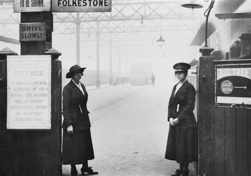 Women ticket collectors at a ticket barrier at Charing Cross station, 1918.