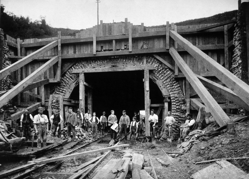 Navvies posing in front of timbering shoring up the north end of the Gill's Corner railway tunnel during its reconstruction in 1892.