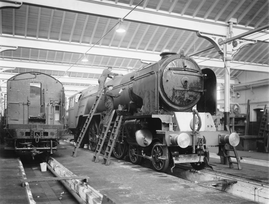 A locomotive being painted