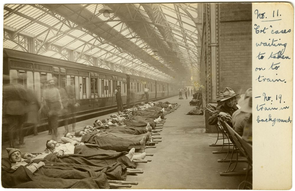 Patients lay on station platform having been taken off the ambulance carriage